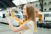 Long-haired woman at railway station — Stock Photo