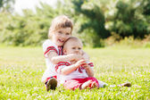 Happy children in russian folk clothes on meadow — Stock Photo