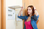 Woman with light-switch in home — Stock Photo