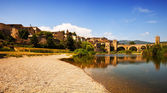 Old european town with antique bridge over river — Stock Photo