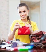 Smiling woman found thing in purse — Stock Photo