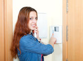 Woman using house videophone — Stock Photo