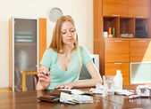 Serious ordinary woman counting the cost of treatment — Stock Photo