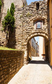 Antique street with arch — Stock Photo