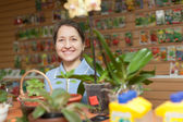 Mature woman in garden shop — Stock Photo
