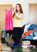 Female traveler packing suitcase — Stock Photo
