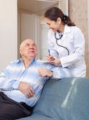 Senior man tells the doctor the symptoms — Stock Photo