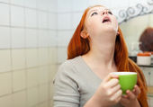 Red-haired teenager gargling throat in bathroom — Stock Photo