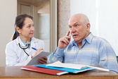 Woman doctor and senior patient — Stock Photo