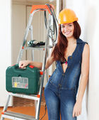 Sexy woman in hardhat with tools — Stok fotoğraf