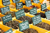 Herbs and tea at counter — Stock Photo