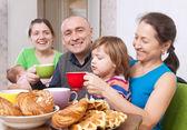 Happy family having tea at home — Stock Photo