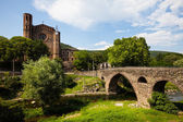 Old church and medieval bridge — Stock Photo