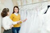 Two women chooses white gown — Stock Photo