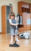 Chica con aspiradora — Foto de Stock