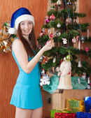 Girl near decoration spruce — Stock Photo