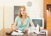 Woman counting the cost of treatment — Stock Photo