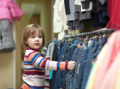 Hild at clothes shop — Stock Photo