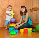 Happy mother and baby plays — Stock Photo