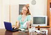 Woman reading about medications — Stock Photo