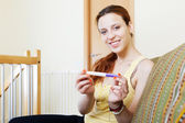 Smiling young woman with pregnancy test — Stock Photo