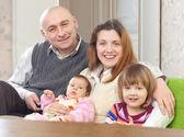 Joyful family of four — Stock Photo