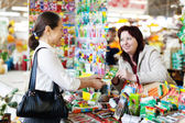 Woman buys seeds in market — Stock Photo