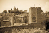Medieval bridge with gate tower — Stock Photo