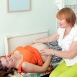 Pregnant woman during medical examination — Stockfoto
