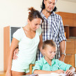 Smiling parents helping with homework — Stockfoto