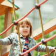 Baby girl climbs the ropes   — Stock Photo