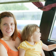 Foto Stock: Mother and child in bus