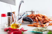 Uncooked seafood and spices in kitchen — Stock Photo