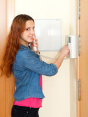 Young beautiful woman using house videophone indoor — Stok fotoğraf