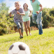 boy with happy parents playing in soccer   — Stock Photo