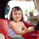 Child in carousel car — Stock Photo #35140057