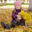 Girl  in  yellow autumn leaves — Stock Photo