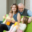 Стоковое фото: Happy family of four together