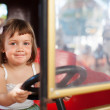 Baby girl in carousel  — Stock Photo