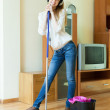 Smiling woman washes the floor with mop — Stock Photo