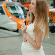 Pregnant woman at railway station — Stock Photo