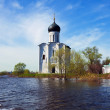 Church of Intercession on River Nerl in flood — Stock Photo #35140581