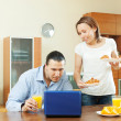 Stock Photo: Positive wife serves morning breakfast her beloved man