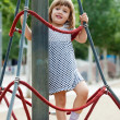 Stock Photo: Child in dress climbing at ropes