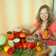Stock Photo: Woman making pickled vegetables