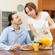 Happy couple having breakfast at home — Stock Photo