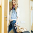 Unhappy woman with luggage leaving  home — Stock Photo