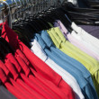 Shirts on hanger at shop — 图库照片