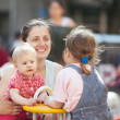 Womwith two children in city playground — Stockfoto #35141227