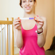 Ordinary womwith pregnancy test — Stock Photo #35141269